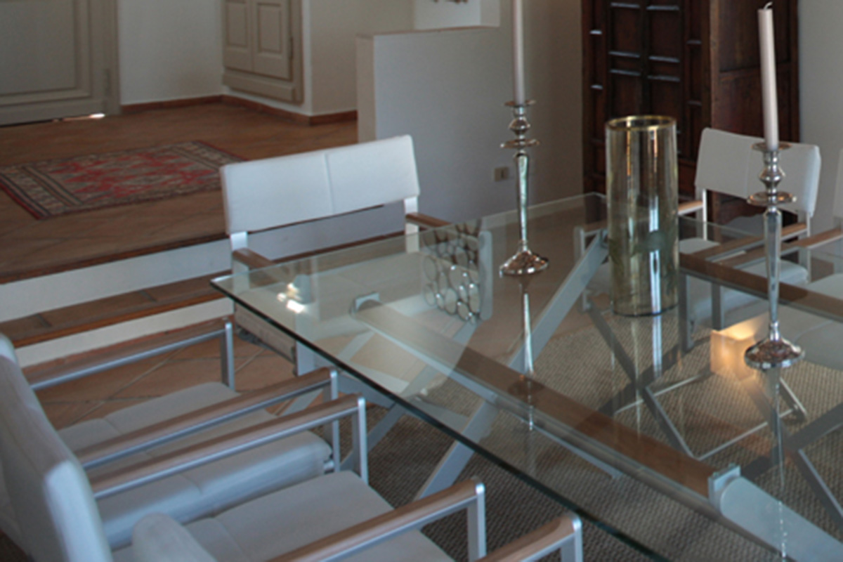 glass table fitted for home interior in villa