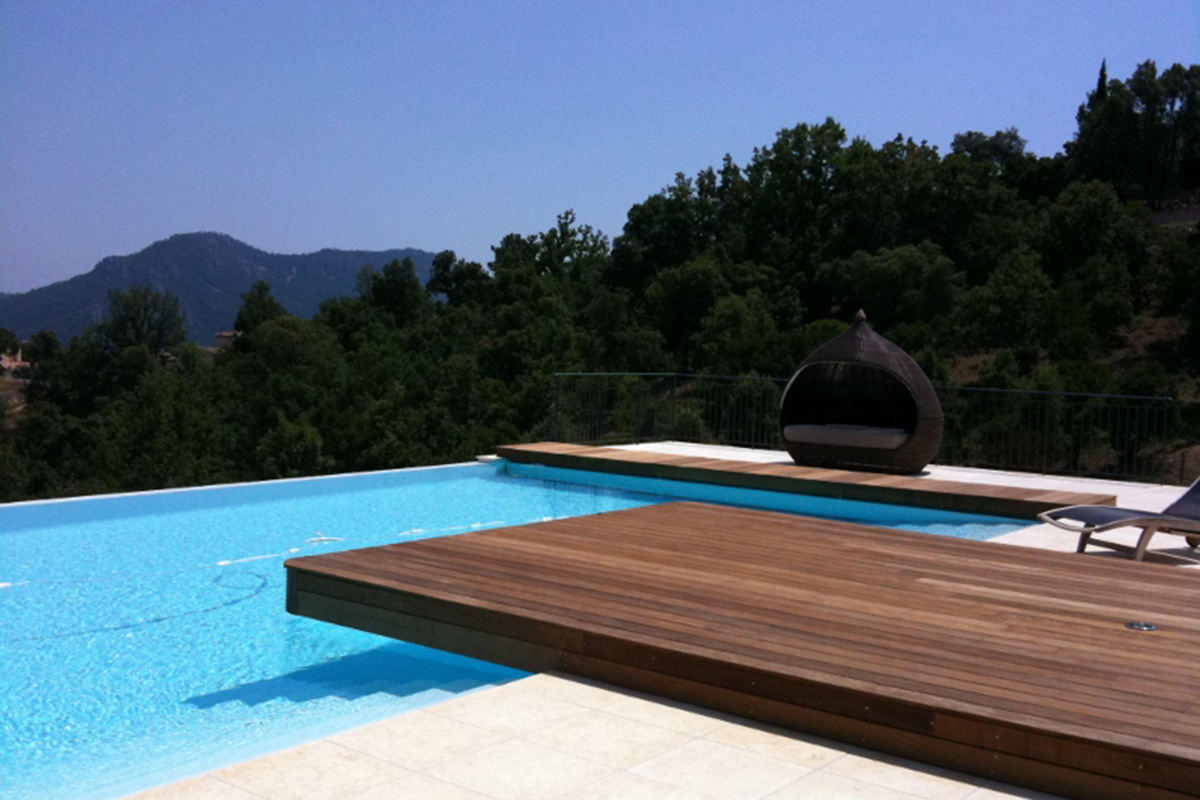 infinity swimming pool design with pod seating in south of france
