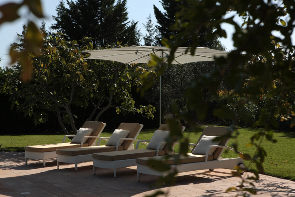 sun loungers design with shade in garden