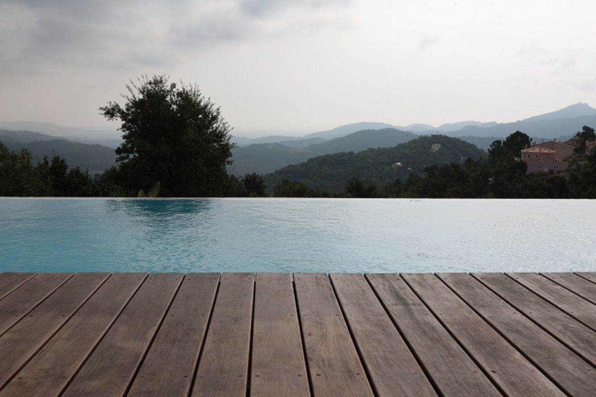 Infinity pool overlooking french hills and timber walkway design