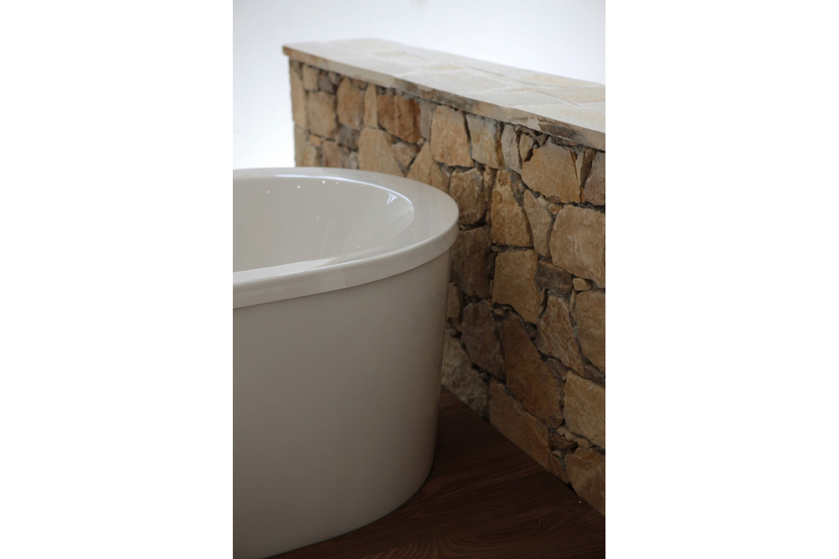 stone wall feature close up with free standing bath