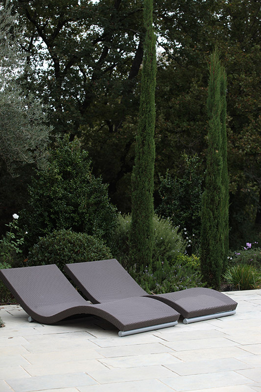 low sun loungers design next to plants