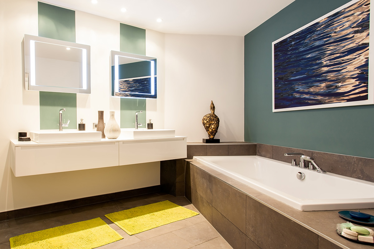 modern bathroom with dual sinks and bath