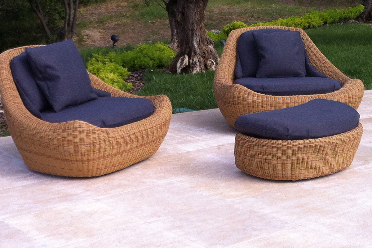 wicker seating for relaxing by the swimming pool