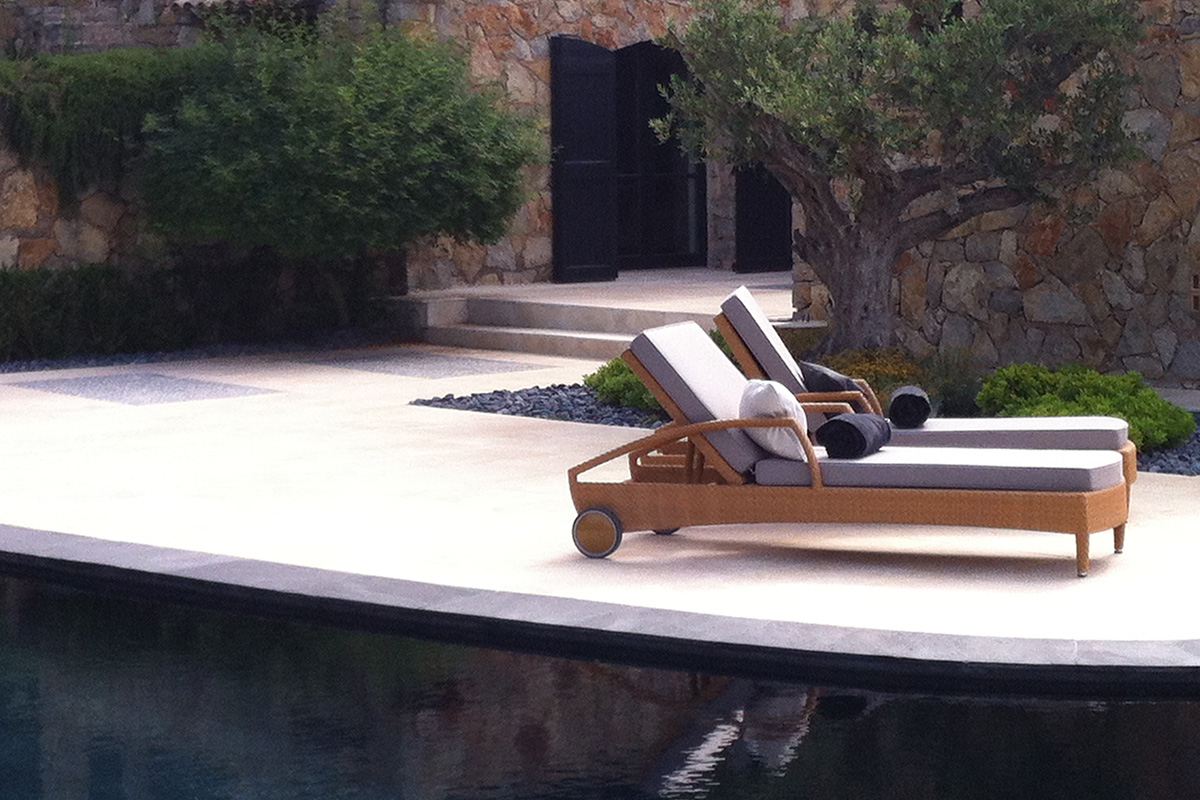 sun lounger with wheels next to pool